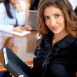 Beautiful business woman with a folder — Stock Photo