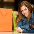 Casual woman with shopping bags — Stock Photo #7642739