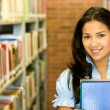 Student in a library — Stock Photo #7642748