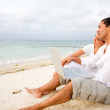 Royalty-Free Stock Photo: Beach couple on a laptop