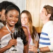 Woman with friends in a bar — Stock Photo