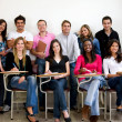 Stock Photo: Friends or students smiling