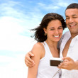 Happy couple taking a photo — Stock Photo