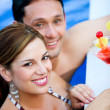 Couple having a drink on vacation — Stock Photo