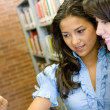 Girls in a library — Stockfoto