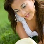 Beautiful girl reading a book — Stock Photo