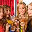 Girl friends in a bar — Stock Photo