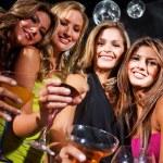 Girl friends in a bar — Stock Photo