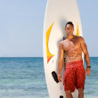 Stock Photo: Surfer on beach