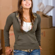 Woman moving homes — Stock Photo #7643385