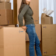 Woman moving homes — Stock Photo #7643386