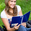 Student smiling outdoors — Foto Stock