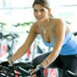 Womdoing spinning in gym — Stock Photo #7643463