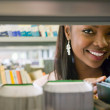 Woman in a library — Stock Photo #7643522