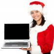 Stock Photo: Christmas girl displaying laptop