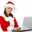 Christmas woman on a laptop — Stock Photo