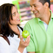 Couple at the supermarket — Stock Photo