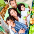 Family at the supermarket — Stock Photo #7643698