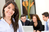 Busines woman in an office — Stock Photo