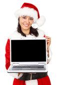Navidad niña mostrando un ordenador portátil — Foto de Stock