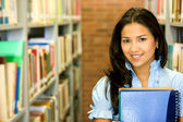 Student in a library — Stock Photo