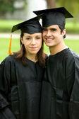 Graduation couple of students — Stock Photo