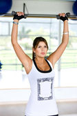 Gym woman lifting weights — Stock Photo