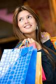Woman shopping smiling — Stock Photo