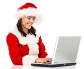 Christmas woman on a laptop — Стоковое фото