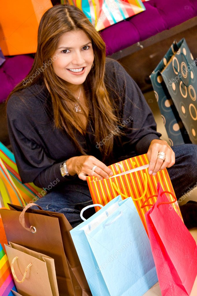 Casual woman with shopping bags in a store smiling  Stock Photo #7642749