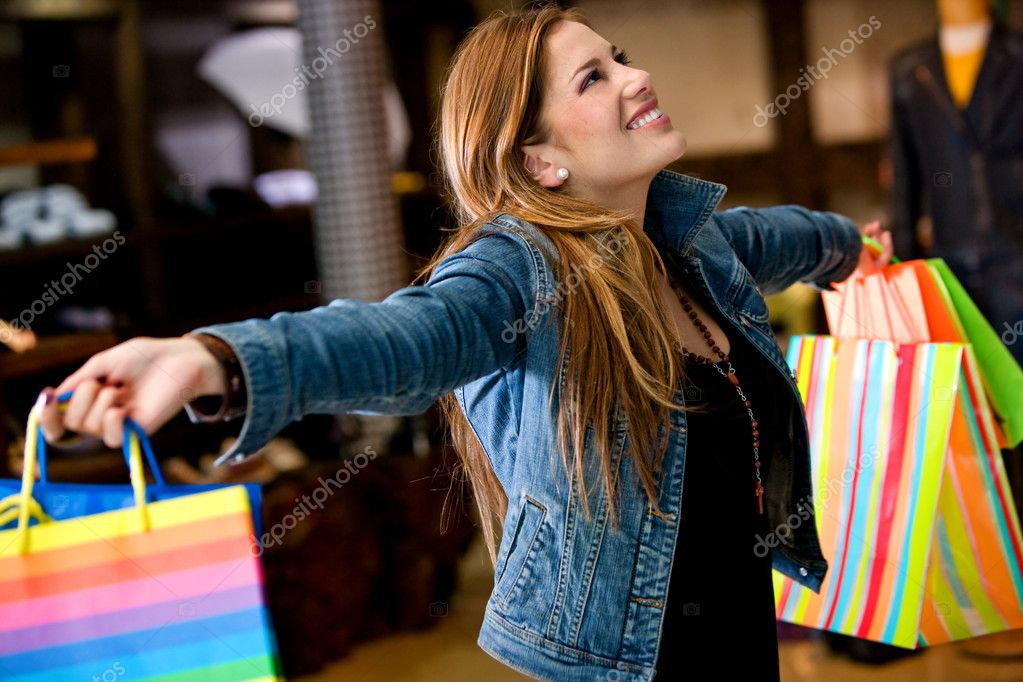 Happy woman with shopping bags in a store smiling — Stock Photo #7642752