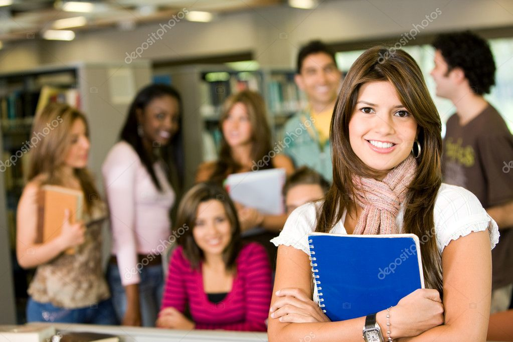Student and teacher looking smiling at the library — Stock Photo #7642754