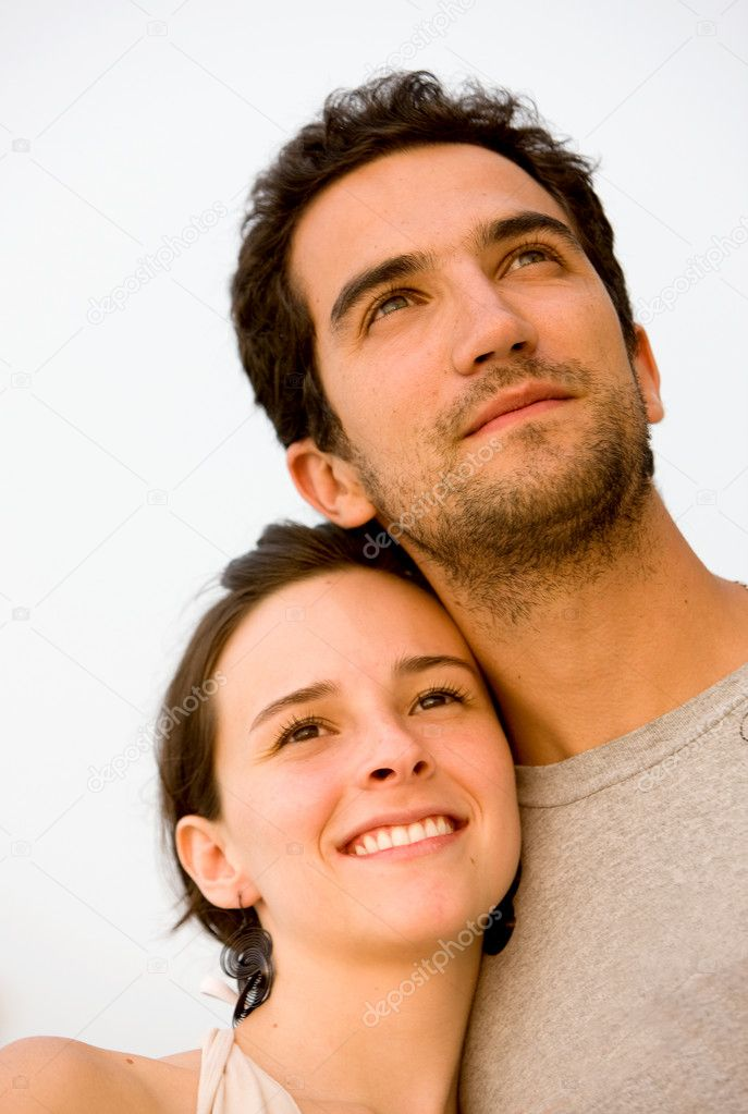 Happy young couple smiling outdoors looking away — Stock Photo #7642755