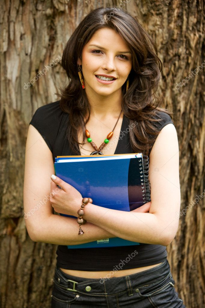 Beautiful young female student with a notebook outdoors — Stock Photo #7642764
