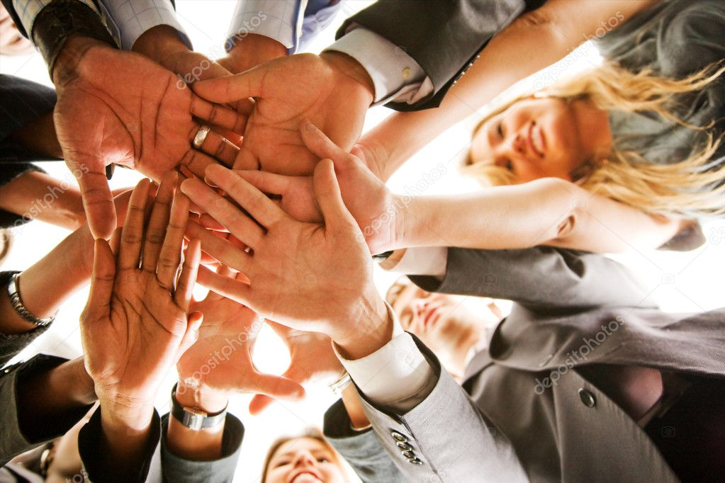 Business teamwork in an office with hands together  Stock Photo #7642825