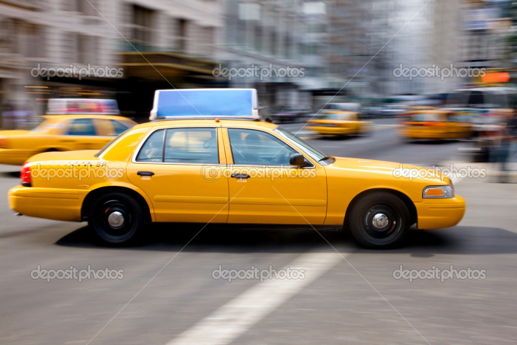 New yourk city yellow taxi on a busy road  Stock Photo #7642941