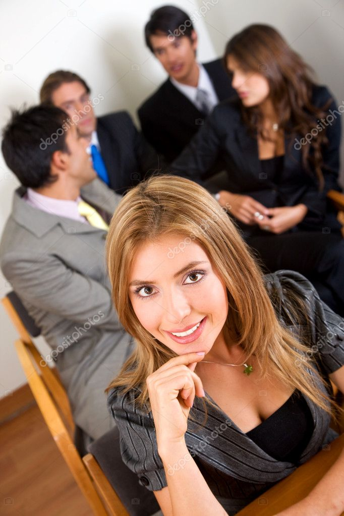 Business team during a meeting in an office - woman leading  Stock Photo #7643046