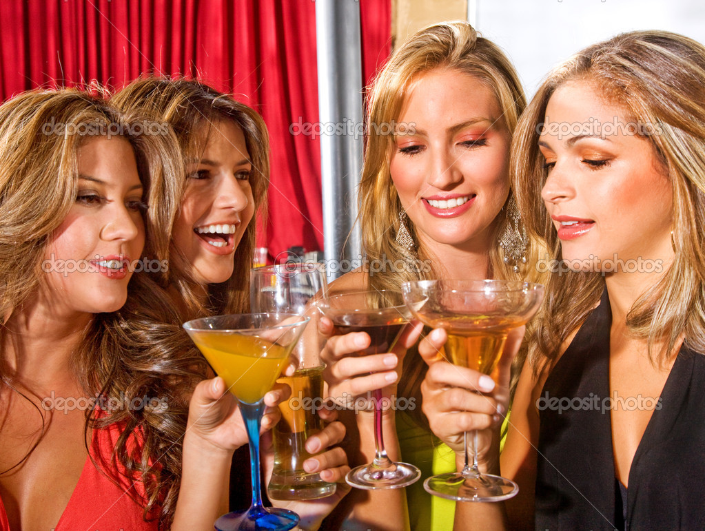 Group of happy girls smiling in a bar or a nightclub — Stock Photo #7643124