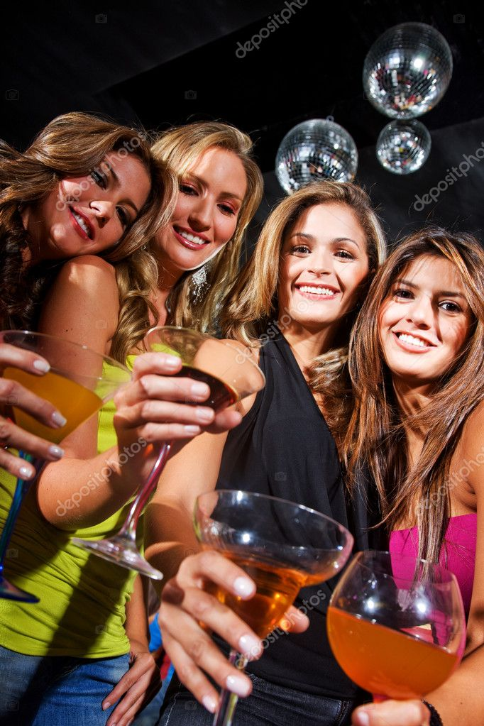 Group of happy girls smiling in a bar or a nightclub — Stock Photo #7643127