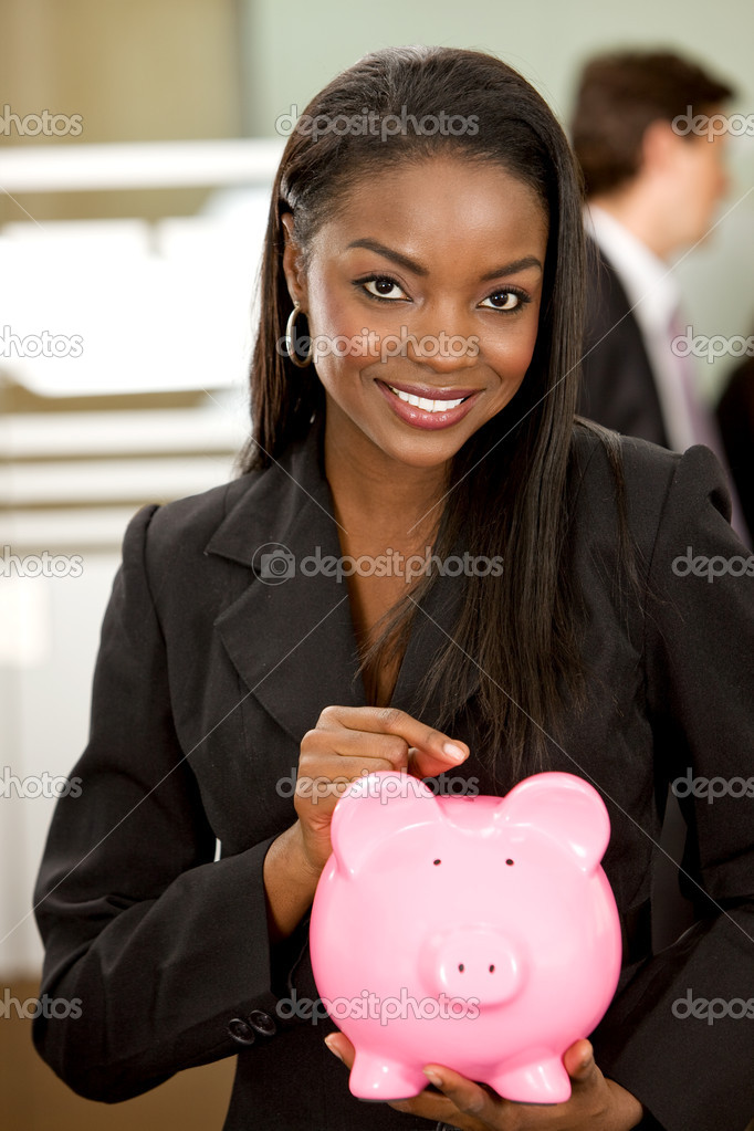 Business woman showing her savings in a piggy bank at her office — Foto de Stock   #7643209
