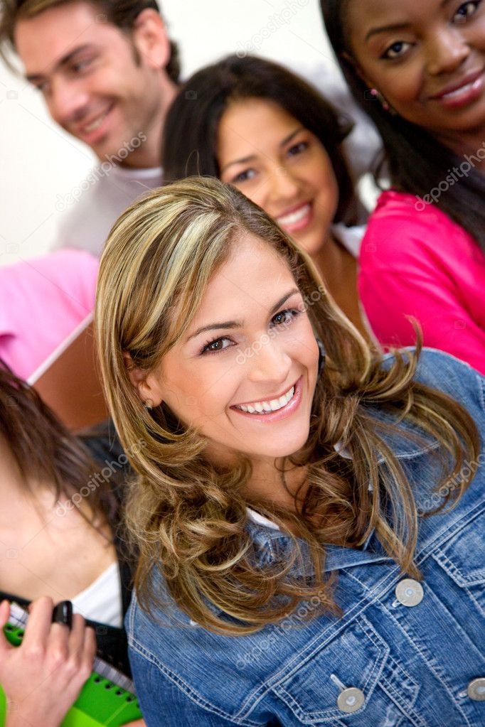 Group of friends or university students smiling in a classroom — Stock Photo #7643371