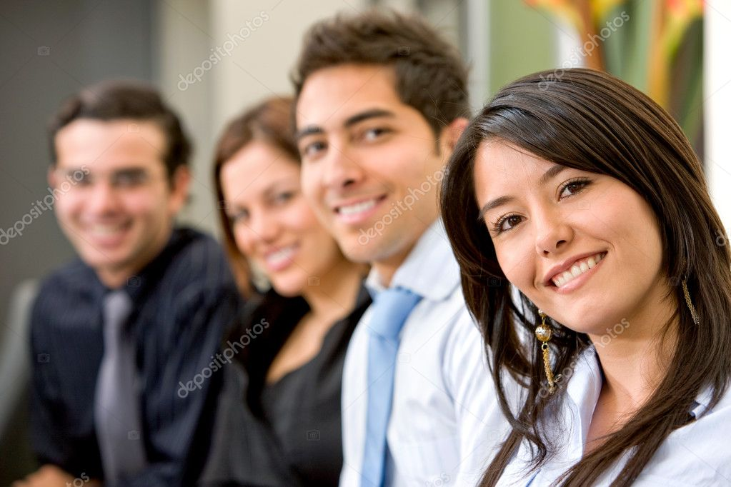 Businesswoman and business team in an office smiling — Stock Photo #7643547
