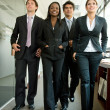 Foto Stock: Business team walking