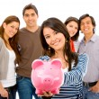 Group of with a piggy bank — Stock Photo