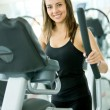 Stock Photo: Womat gym - cardio