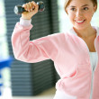 Female lifting free weights — Stock Photo #7654212