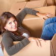 Woman in a moving box — Stock Photo
