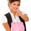 Woman with a piggybank — Stock Photo #7654289