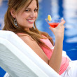 Woman by the swimming pool — Stock Photo