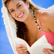 Woman on vacation reading — Stock Photo #7654361